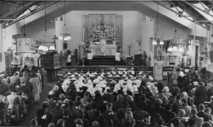 A Communion Mass being held in the current Church building.